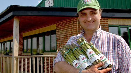 Andy Allen with some of his asparagus at his farm shop at Portwood Farm, Great Ellingham. Photo: Den