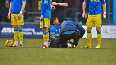 Michael Clunan is a doubt after a poor challenge by a Redditch player Picture: Jamie Honeywood