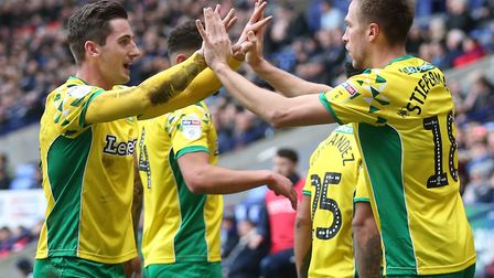 Kenny McLean, left, congratulates Marco Stiepermann on putting Norwich City 2-0 up at Bolton Picture