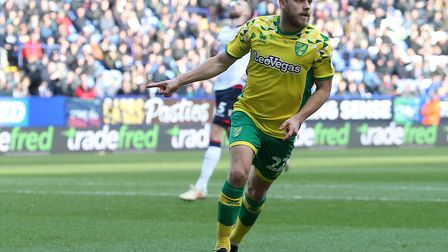 Teemu Pukki celebrates opening the scoring for Norwich City at Bolton - and setting them on their wa