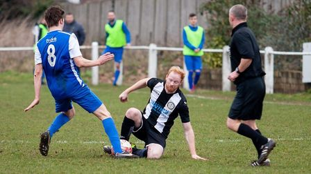 David Weaver-Pope going to ground to make the challenge for Swaffham in their 2-2 draw with Cornard