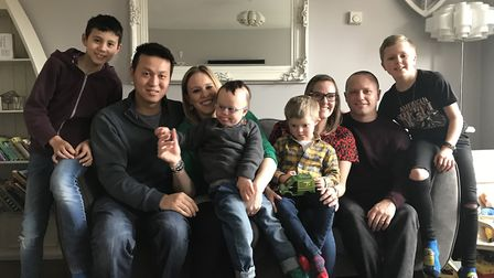 Mason Lee and Eli Taylor have down syndrome, picture here with their families. From left to right: J