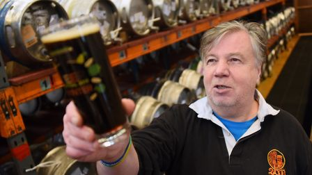 Organiser Martin Ward checks the clarity of one of the Norfolk beers during preparations for the 201