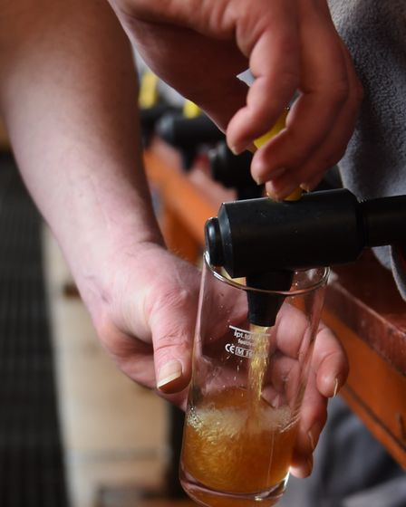 A Norfolk beer is sampled during preparations for the 2019 Great British Winter Beer Festival at St