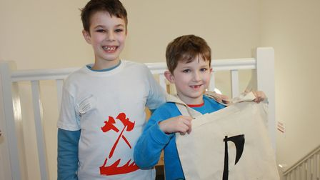 Henry, 8, and Edward, 5, with their Viking-themed tee shirts and tote bags.Photo: KAREN BETHELL