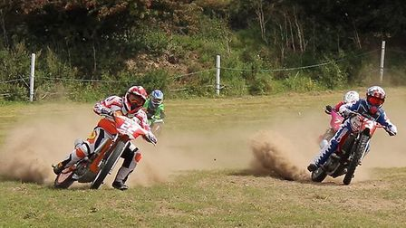 Kenzie Cossey reaching speeds of up to 60mph while competing in grasstrack races. Picture: Tracy Cos