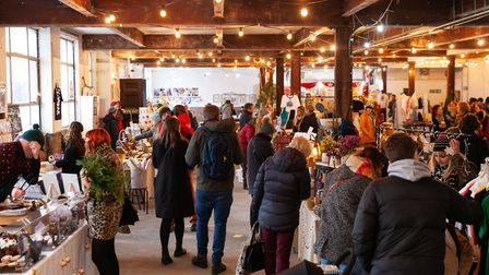 Locals enjoy locally made cakes and clothes at the Fresh Artisan Christmas Market. Image: Isaac Harg