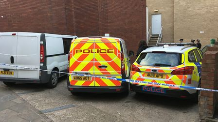 Police at the scene where Remigijus Balsevicius was found dead, in Old Post Office Court, Norwich. P