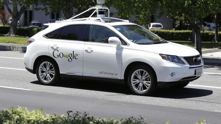 A Google self-driving car goes on a test drive near the Computer History Museum in Mountain View, Ca
