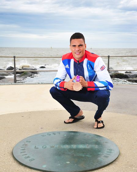Olympic Boxer Anthony Ogogo with his Bronze medal on Ness Point in Lowestoft.