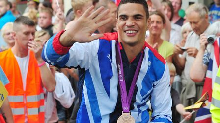 Olympic bronze medallist Anthony Ogogo waves to the Lowestoft crowd on his parade around the town. P