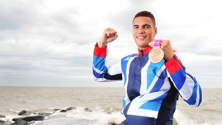 Olympic Boxer Anthony Ogogo with his Bronze medal on Ness Point,Lowestoft.