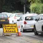 Cars queue in rush hour traffic. Photo: Gregg Brown