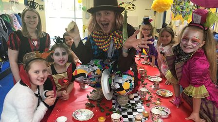 Mr McCowen hosts a Mad Hatter tea party to celebrate World Book Day at Howard Junior School. Photo: