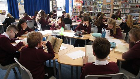 Year 7s at Litcham School carrying out a sponsored silent read to raise money for the Litcham School