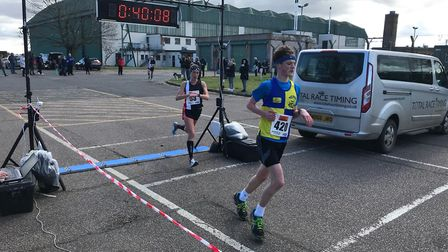 Norwich Road Runners' Amy Beck comes over the finish line at the Mad March Hare 10K. Picture: Mark A