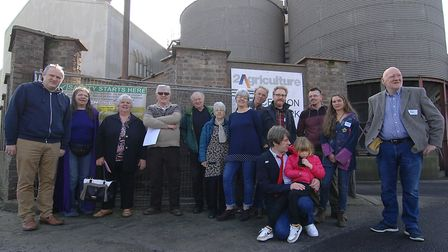 Villagers outside the mill in Stoke ferry, which could be demolished to make way for new homes Pict