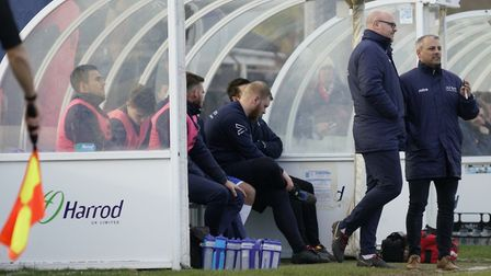Lowestoft boss Jamie Godbold, right, and assistant Andy Reynolds discuss tactics during the game aga