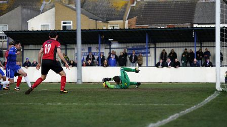 Lowestoft's Marcus Wilkinson taking a shot, which is saved by Kettering keeper Paul White Picture: