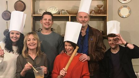 The cast of Caroline's Kitchen get a cooking lesson from chef Richard Hughes