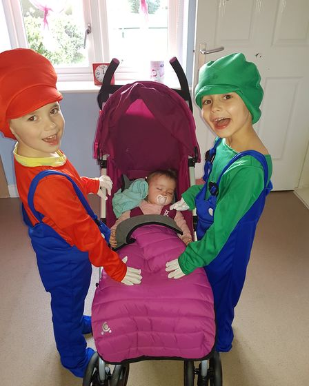Ollie Davis, aged 7, and Charlie Read-Cook, aged 5, with 8 month old baby sister Isla Warmer on Worl