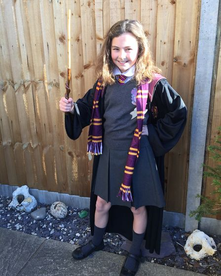 Sophie White, aged 10, dressed as Hermione Granger with a wand made by her grandad. Photo: Steven Wh