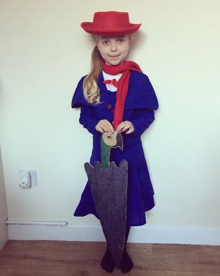 Isabella Murrell, aged 4, with her first World Book Day dressed as Mary Poppins with the umbrella sh