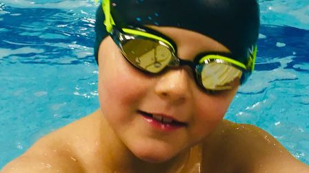 Norwich FC under 9 player Lynden Long, 8, will be swimming his second Swimathon to raise money for c