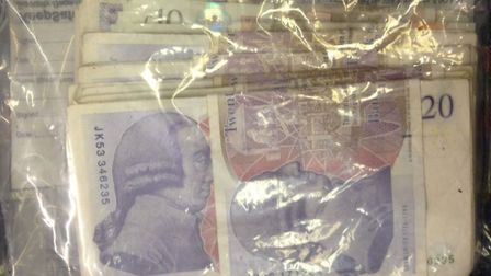 Five people were arrested after a stash of cocaine and wads of cash were seized in a drugs raid in N