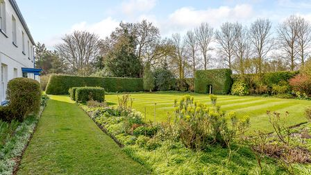The surrounding gardens are well-maintained. Picture: Savills