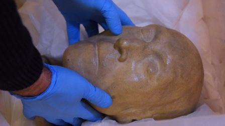 The cast of prison reformer Jeremy Bentham's head is removed from Norwich Castle Keep in preparation