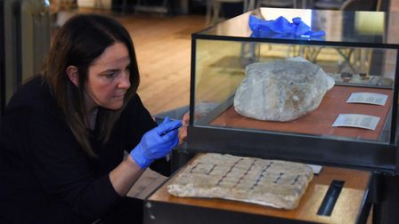 Debbie Harris, senior conservator, opens one of the cases as artefacts are removed from Norwich Cast