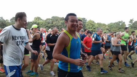 Jack Cheung (centre) and his brother Dick (behind) taking part in Catton parkrun in memoryu of their
