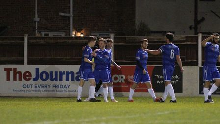 Cion Wren (left) is congratulated by team-mates after scoring what proved to be the only goal of Low