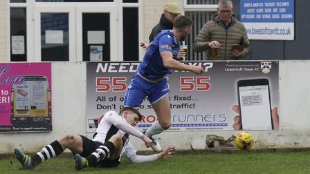 Lowestoft Town's Shaun Bammant is tackled by Coalville Town's Andrew Burgin during Saturday's 2-1 ho