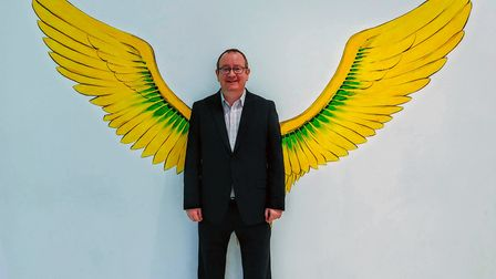 Robert Bradley, centre manager at Castle Mall in Norwich, stands in front of a new art piece at the
