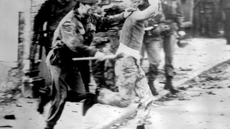 A member of the Parachute Regiment clashing with a rioter on Bloody Sunday. Picture: PA