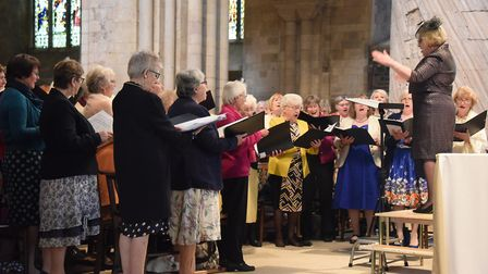 Margaret Collingwood, chairman, conducts the WI choir during the Norfolk Federation of WIs Centenary