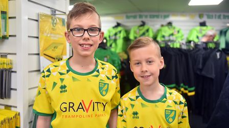 The Norwich City fan signing with Alex Tettey and Grant Hanley at the Carrow Road Club Shop, Norwich