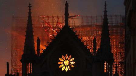 Flames and smoke rise from Notre Dame cathedral as it burns in Paris on Monday. (AP Photo/Thibault C