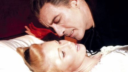 Christopher Lee sinks his teeth into his latest victim in Hammer's Dracula Photo: Hammer