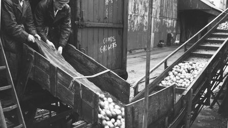 """Gaymers Cider Worksin Attleborough, 30 November 1949. """"Smiley"""" Simons on the left and Frank Self on"""