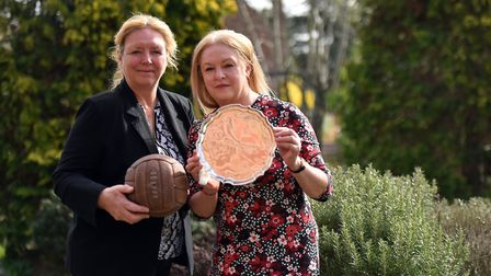 Ralph Hunt's two daughters, Ashley Hunt-Vlietstra, left, holding one of Ralph's hat-trick footballs