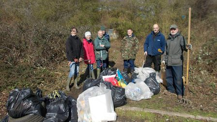 Members of the Fakenham Area Conservation Team cleaned up the area near Morrisons on Holt Road and t