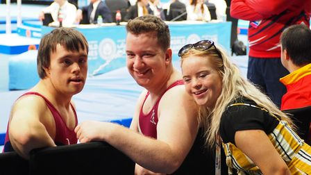 Shane Baxter (centre) who won gold medals in the vault and parrallel bars and a silver medal in arti