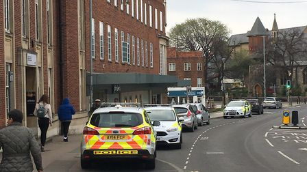 Police have detained two people after staff at John Lewis in Norwich were threatened by a suspected