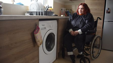 Wheelchair bound Faye Eastwood struggles to reach the the sink which is too high, and the kitchen un