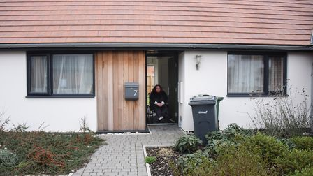 Wheelchair bound Faye Eastwood at the door of her social housing home at Little Melton. Picture: DE