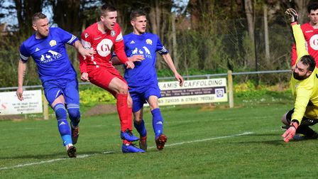 Sheringham (red) and leaders Caister are locked in a battle for the Anglian Combination Premier Leag