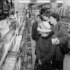 Customers looking at christmas confectionery at Woolworths in Wymondham, 3 December 1981. Photo: Arc